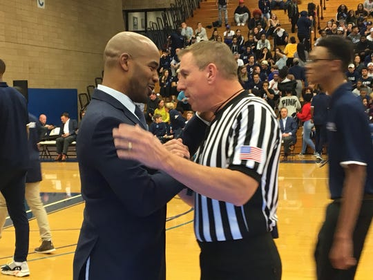 Shaheen Holloway greets one of the officials prior to his debut vs. Lafayette