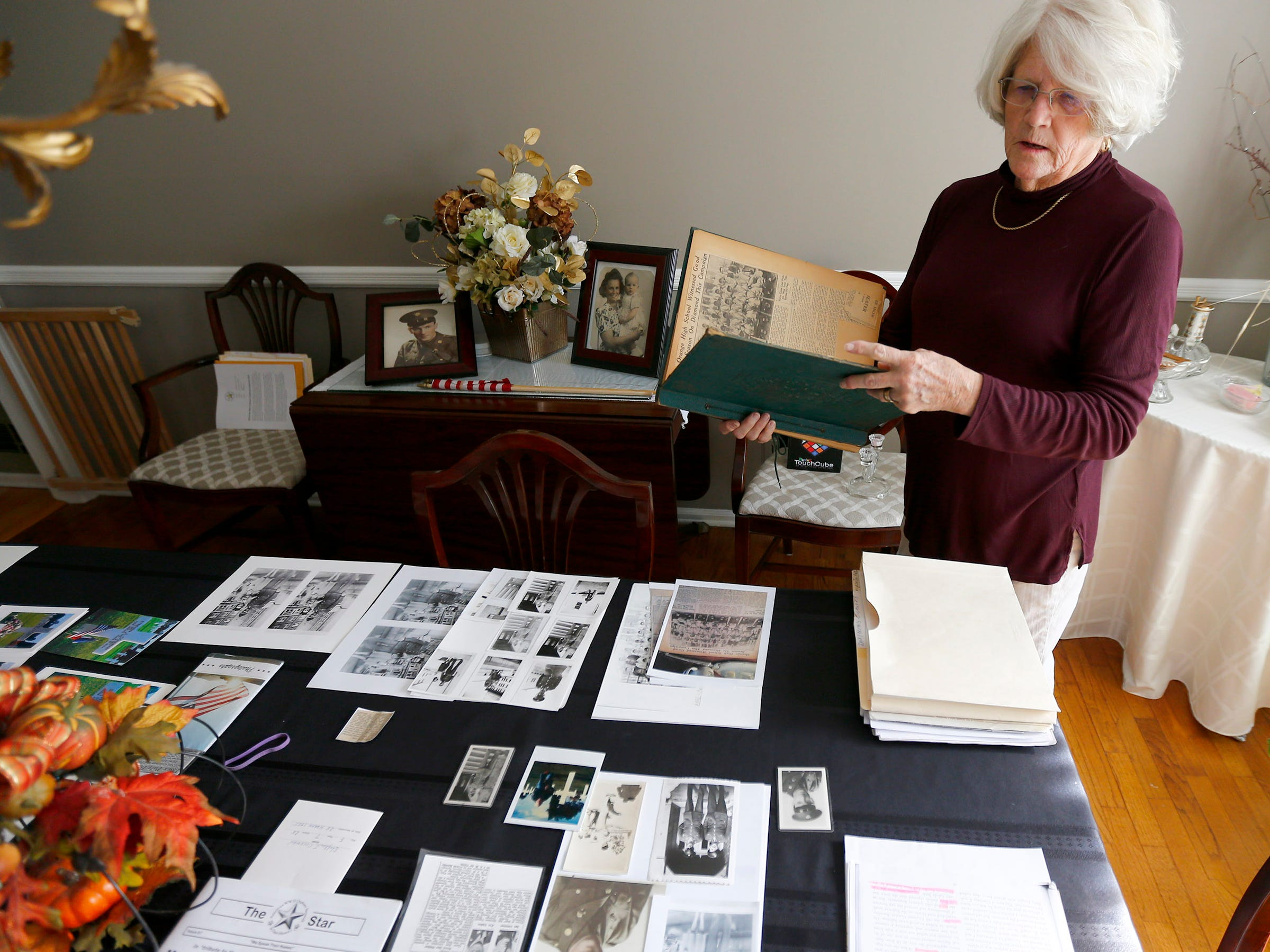 Carol Donahue looks over memorabilia of her father, Stephen J. Coleman, in her Colts Neck home Thursday, November 8, 2018.  He was killed in the D-Day invasion.