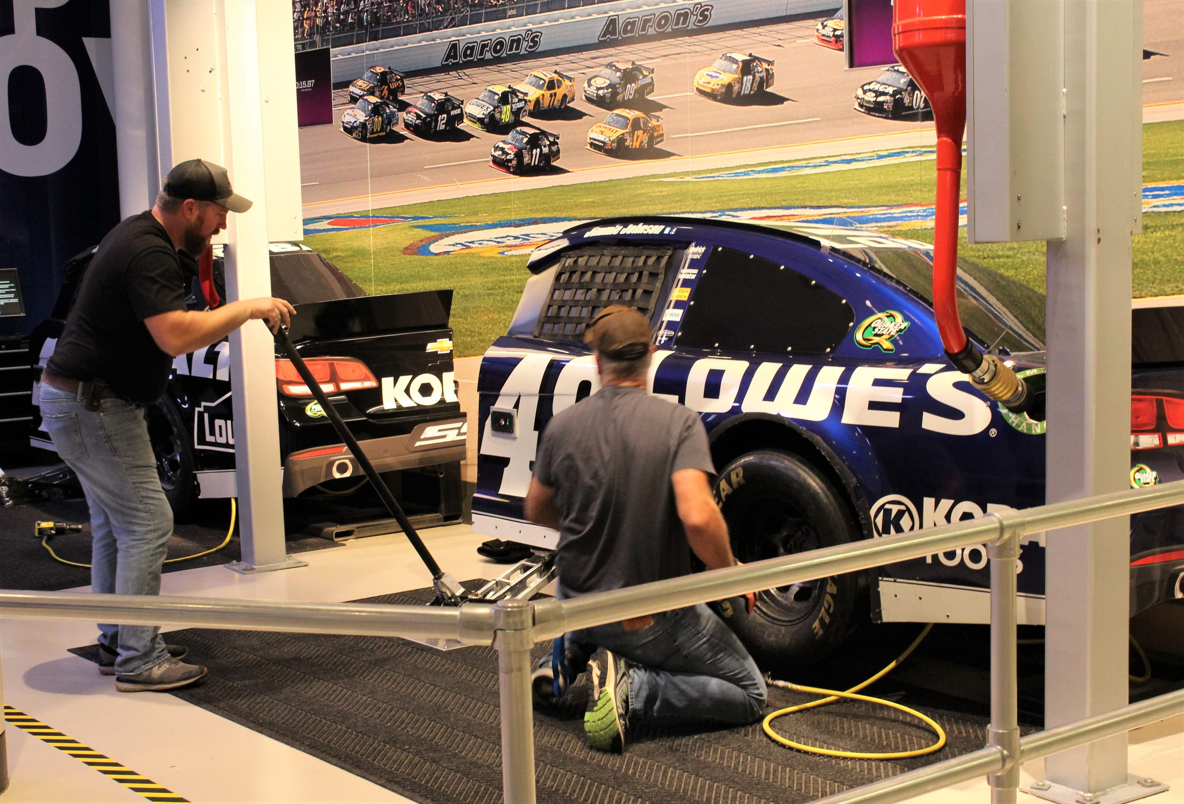 Hands-on activities at the NASCAR Hall of Fame include a timed pit stop, where participants can change a tire and top off of the tank, hopefully under 15 seconds.
