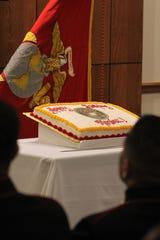 Centerstage Thursday was the birthday cake, celebrating the 243rd year of the U.S. Marine Corps. The first slices go to the youngest and eldest Marines in attendance, which required four cuts with a sword this year.