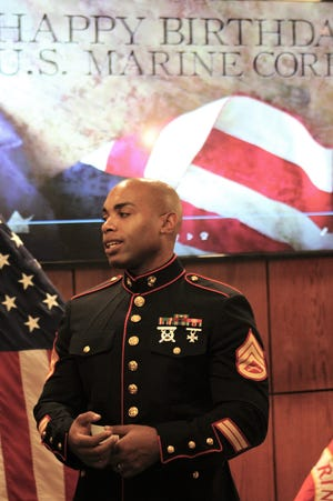 Staff Sgt. Jamal A. Bailey speaks with guests and other Marines after Thursday's cake-cutting at the West Texas Rehabilitation Center. He is from Virginia.