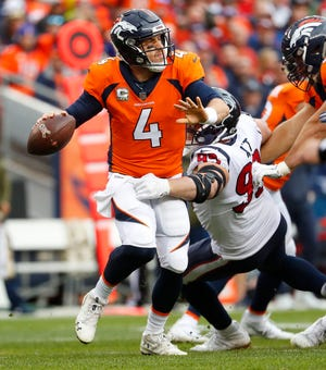 Houston Texans defensive end J.J. Watt (99) pressures Denver Broncos quarterback Case Keenum (4) during the first half Sunday, Nov. 4, 2018, in Denver.