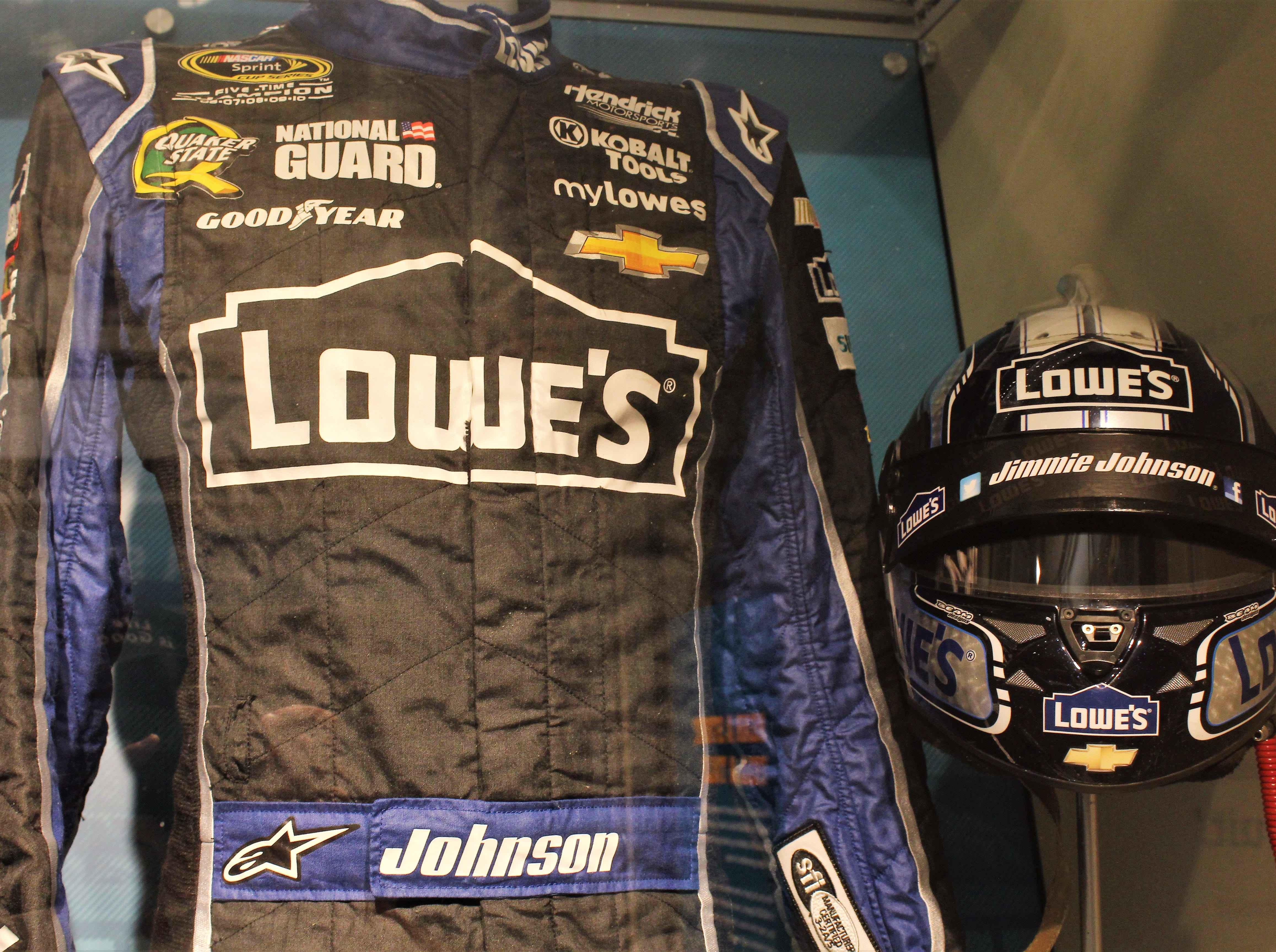 Gear on display at the NASCAR Hall of Fame includes driver suits and helmets.