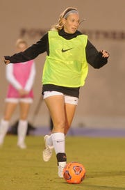ACU's Brooke Lenz plays the ball during a drill in practice Wednesday at Elmer Gray Stadium.