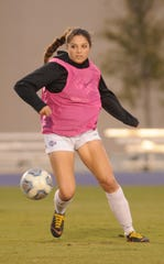 ACU's Alyssia Anuat works on a drill in practice with the soccer team.