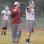 De Leon offensive coordinator Kody Yeager, left, instructs senior quarterback Kevin Yeager, his brother, during practice Wednesday.