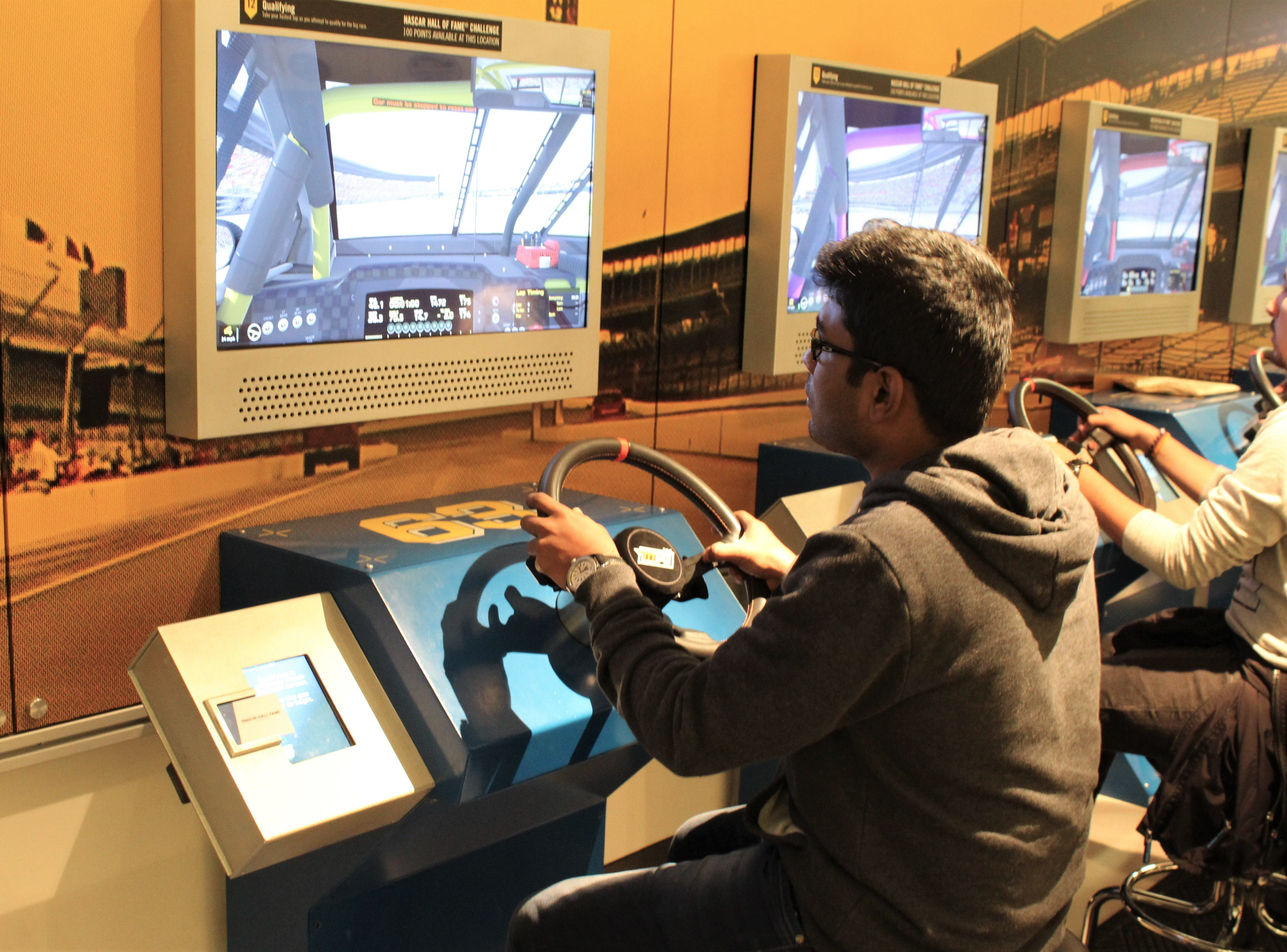 "A hand-on activity at the NASCAR Hall of Fame placed ""drivers"" at the wheel of race car qualifying for position at Texas Motor Speedway, which was the next race. Yes, you could crash but, no, you wouldn't get hurt."
