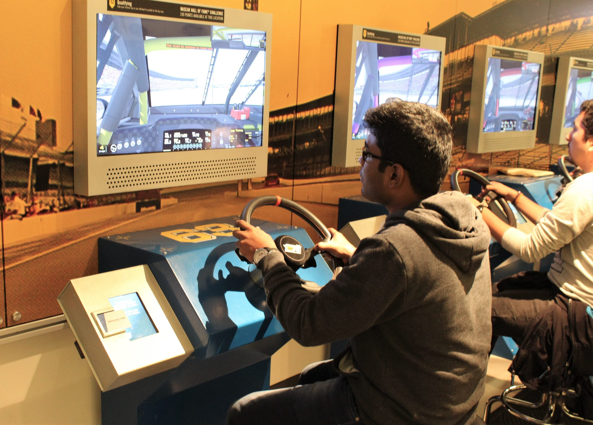 "A racing simulator at the NASCAR Hall of Fame placed ""drivers"" at the wheel of a race car qualifying for position at Texas Motor Speedway, which was the next race. Yes, you could crash but, no, you wouldn't get hurt."