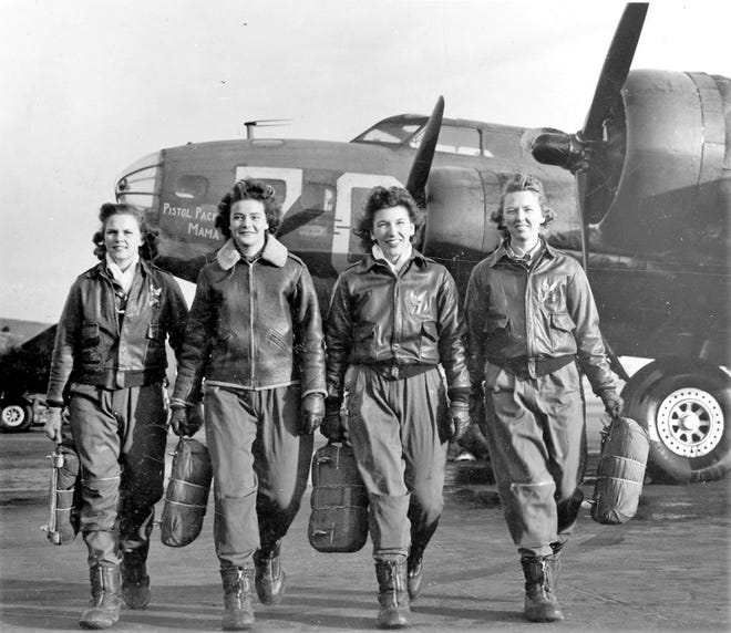 "WASP Pilots in front of a B-17 known as ""Pistol Packin Mama"" at an airfield in Ohio."