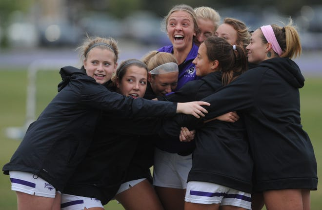 ACU women's soccer players get in a group hug before practice Wednesday at Elmer Gray Stadium. The Wildcats, the Southland Conference champions, were preparing for their NCAA Division I tournament opener Saturday against Baylor.
