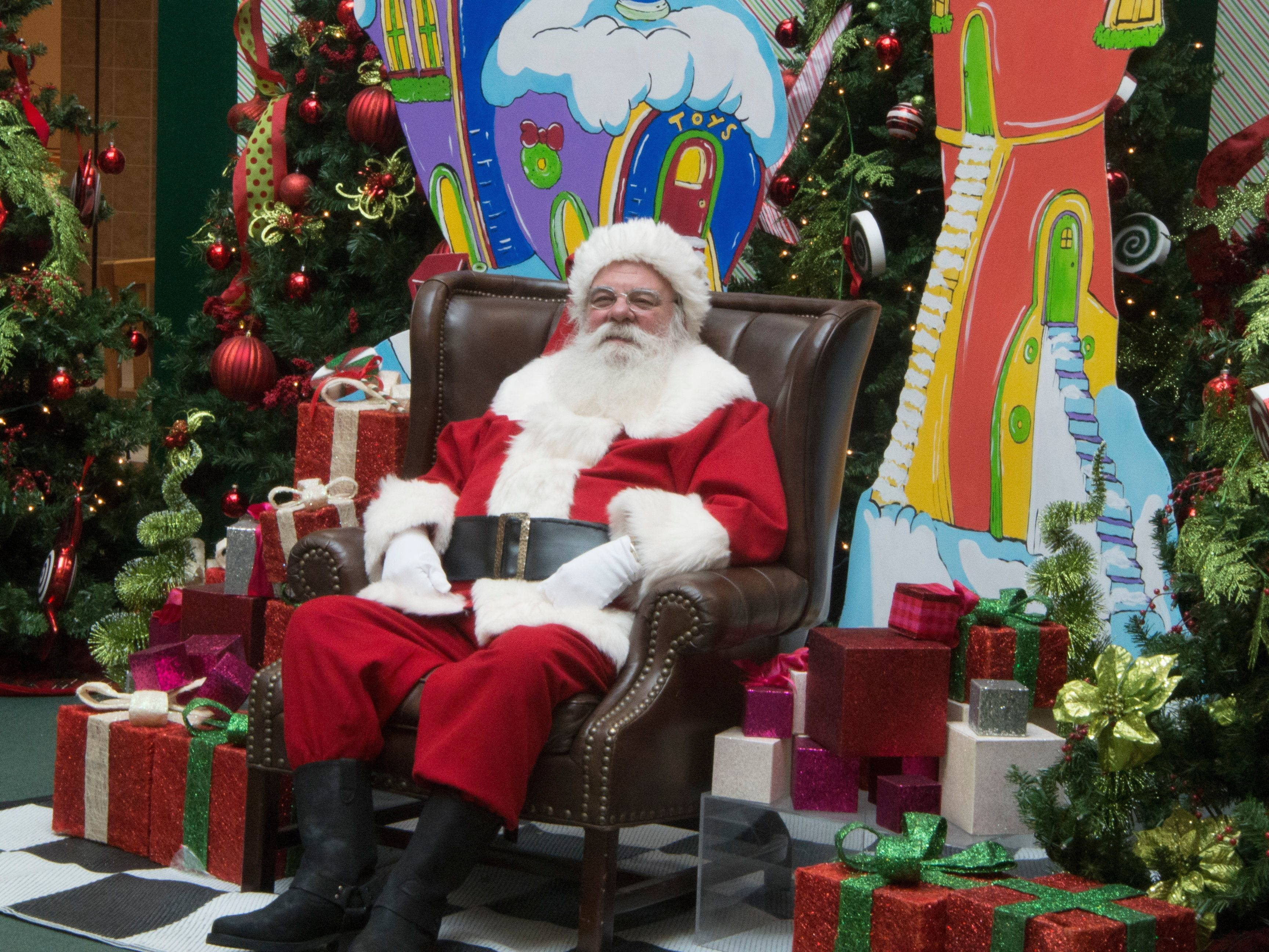 Santa Claus awaits his next visitor at the Oakdale Mall in Johnson City on  Dec. 13, 2017.