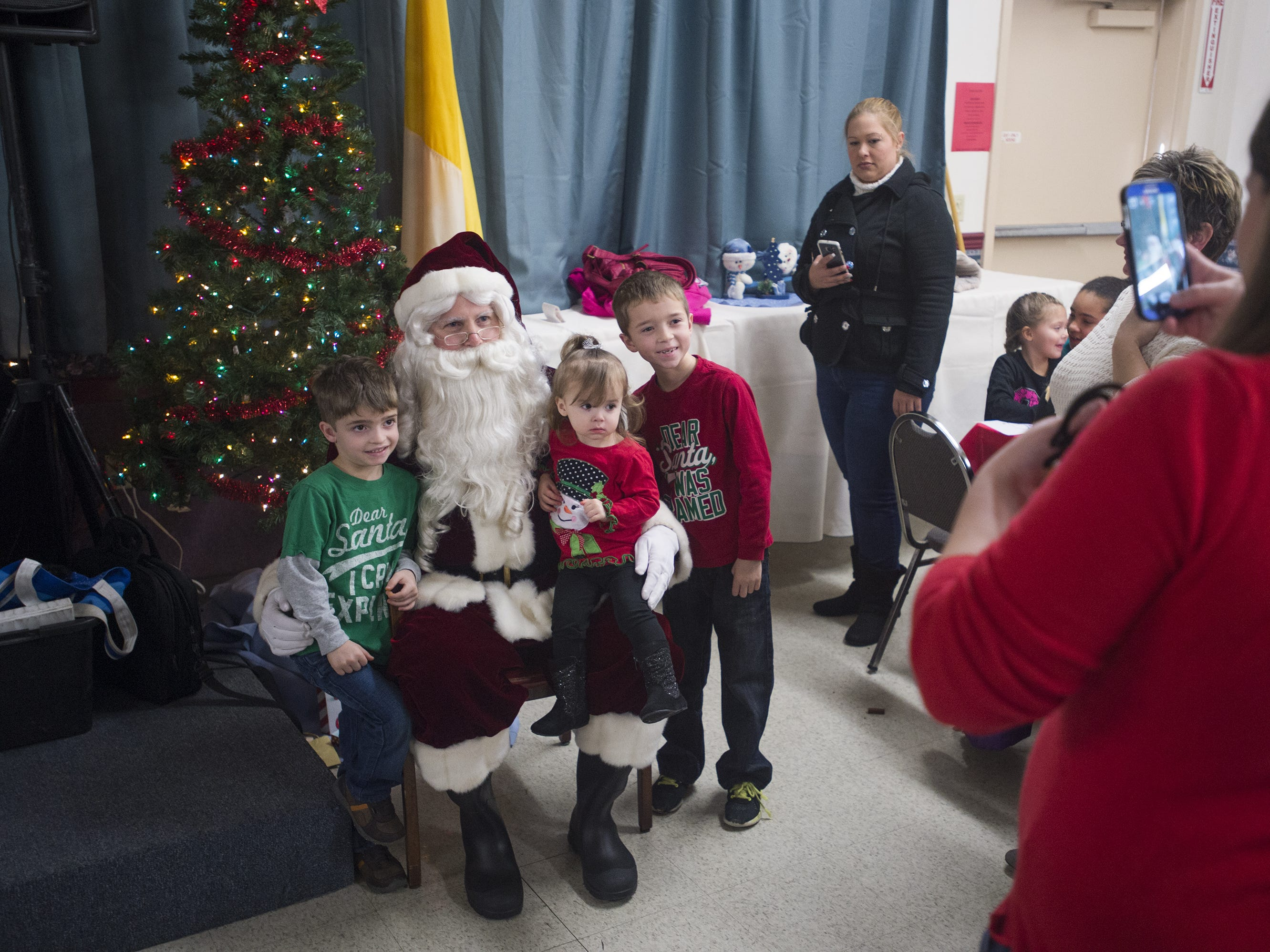 Santa poses for a photo during Animal Adventure's Jungle Bells event in Binghamton in 2015.