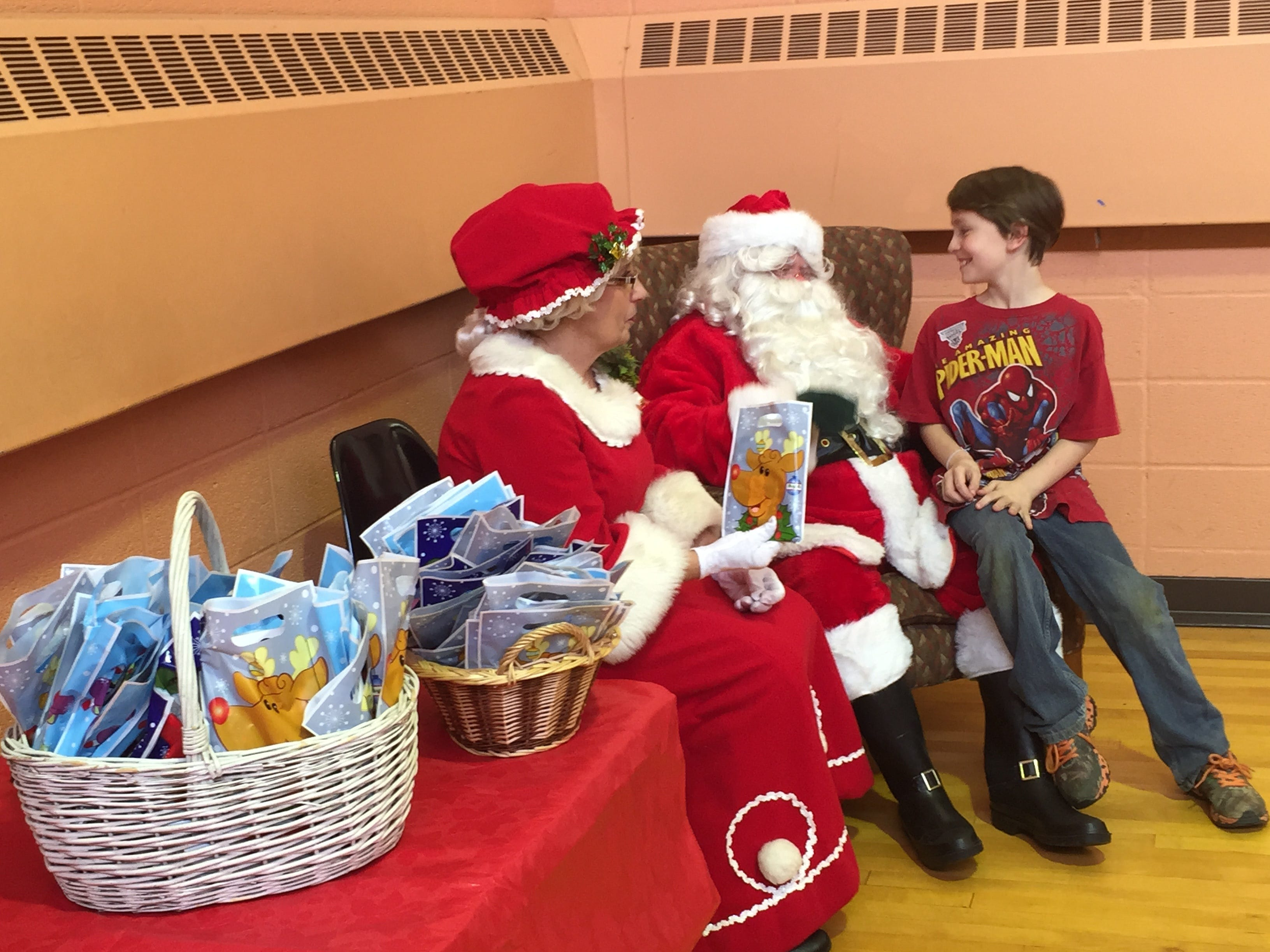 Brendon Dixon, 9, meets Santa and Mrs. Claus  as part of Kirkwood's Hometown Christmas in 2015.