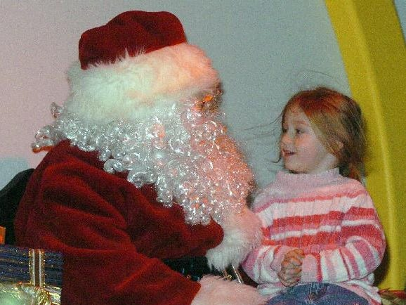Paige Drumm, 3, of Endicott sits on Santa's lap, aka Binghamton's Ted Nappi's lap, at Roberson Museum in 2004.