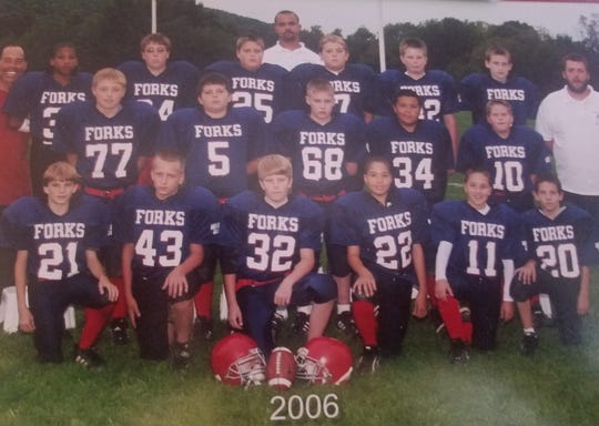 Members of the Chenango Forks Youth Football program in 2006. Jamie Allen, center rear, has volunteered for the program for 17 years.