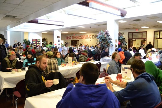 One of Binghamton High School's two cafeterias filled with community members for the school's 20th annual community Thanksgiving Day dinner in 2015.