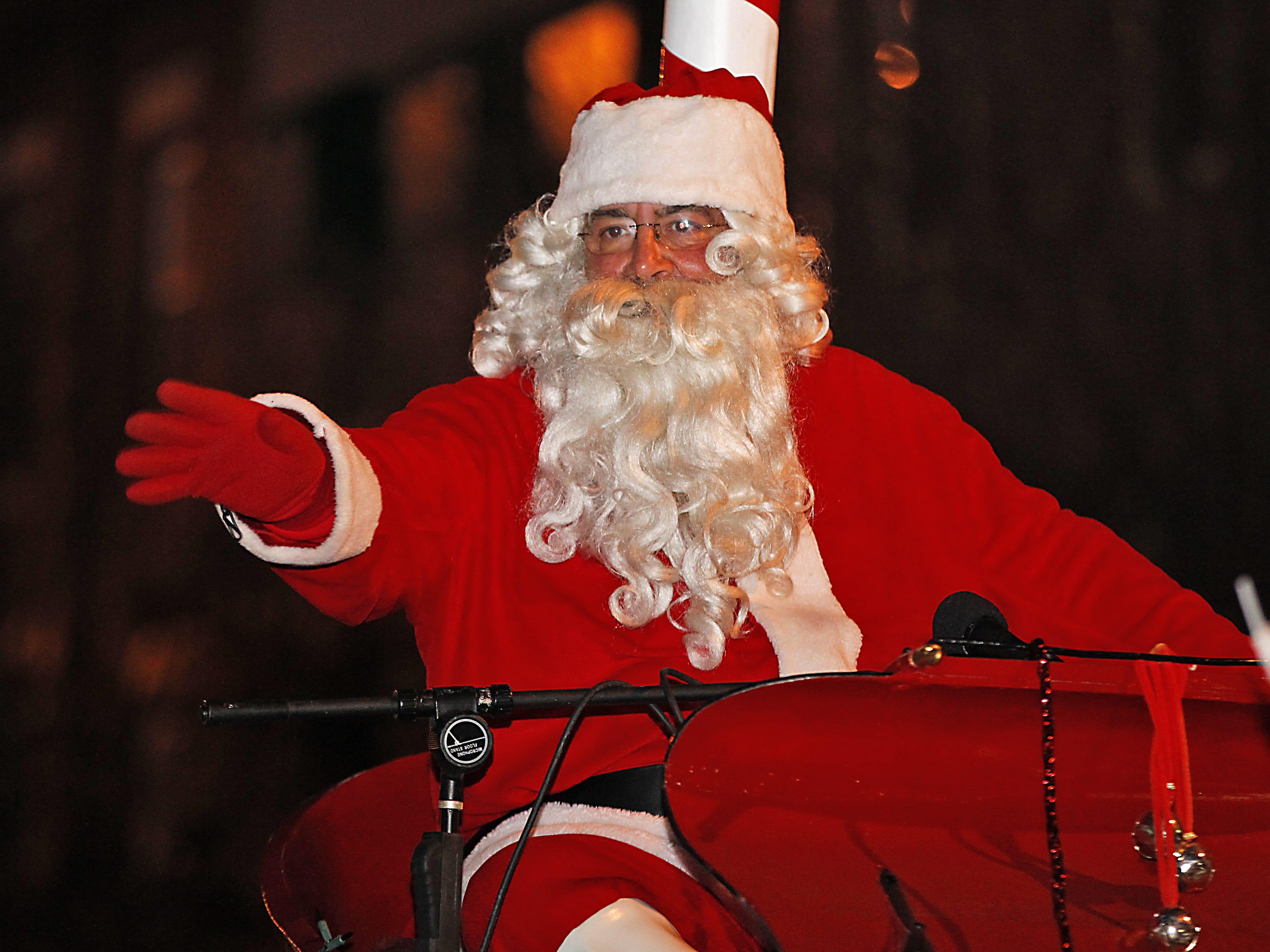 Santa makes an appearance Saturday at the Endicott Holiday Parade on Washington Avenue on Dec. 5, 2015.