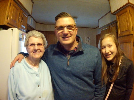 Christopher Sievers, center, with his grandmother, Helen Grannis and his daughter, Gabby.