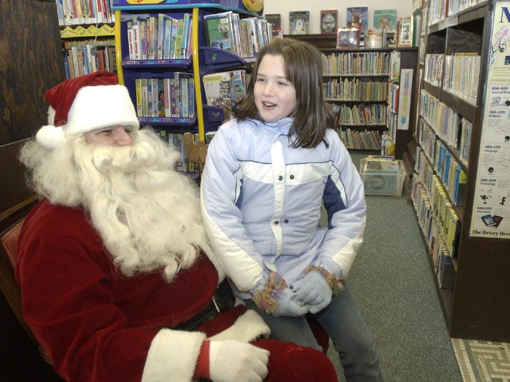 In 2004, Taylor Landon, 9, of Greene describes her wish list with Santa Claus Saturday morning in Moore Memorial Library during Greene's Home Holiday Weekend. Taylor's focus for this Christmas was on dolls and new things for her room.
