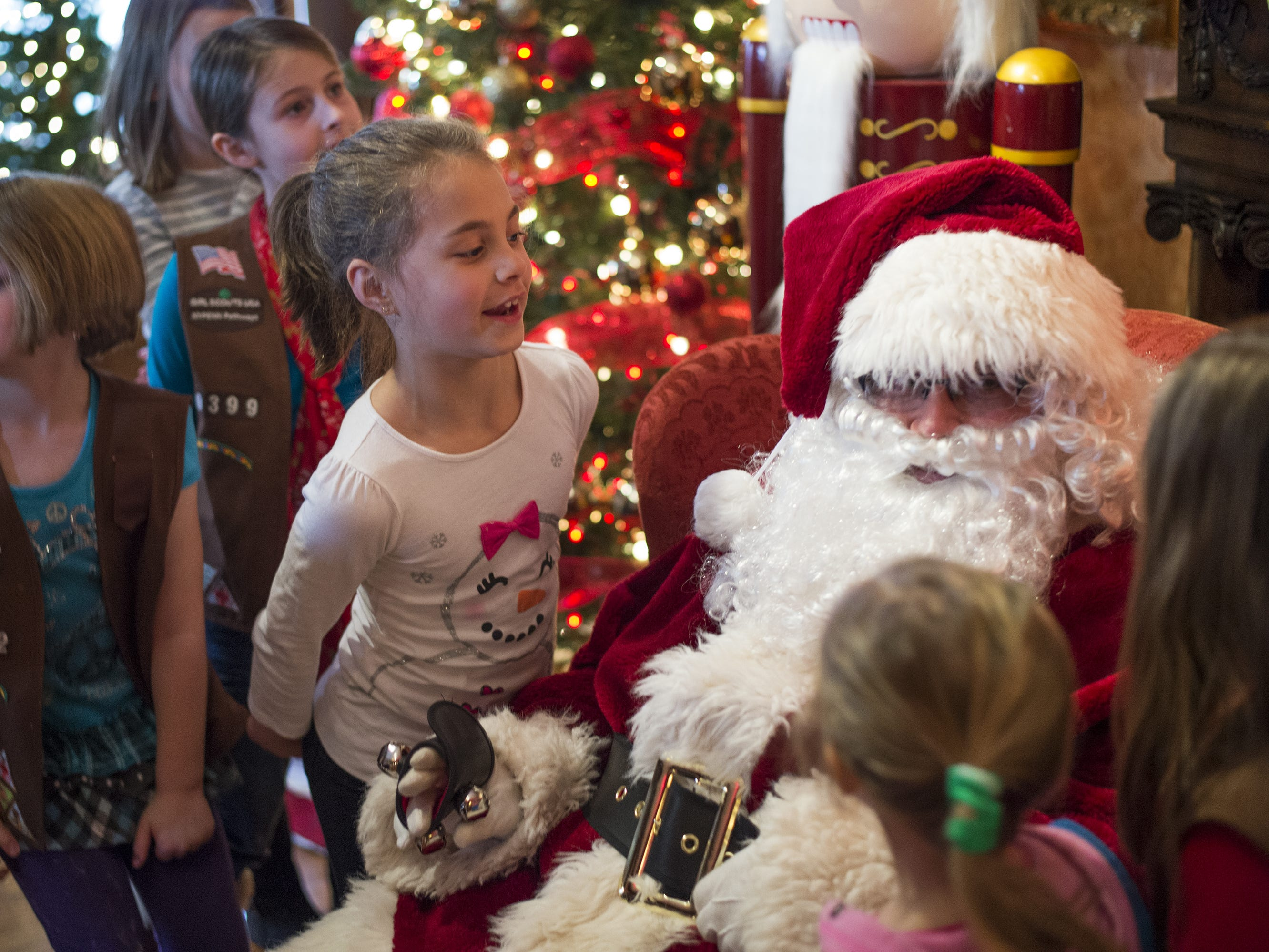 In 2015, Audrey Tulsey, 7, of Vestal, greets Santa with members of Girl Scout Troop 30262 at the Roberson Museum in 2015.