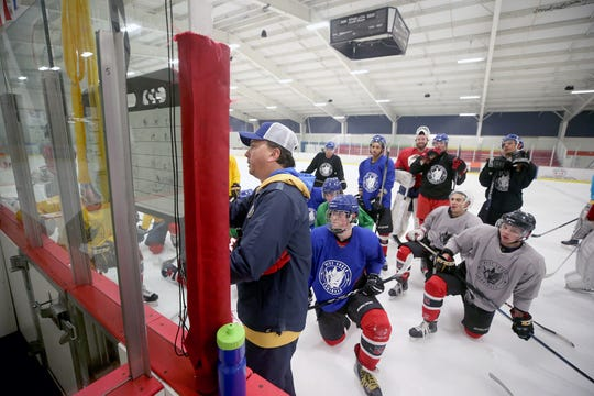 David Daniello, center, plays several roles with the West Sound Admirals junior hockey team.