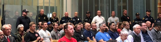 Many members of the Bremerton Fire Department fill the city council chambers at the Norm Dicks Government Center Wednesday night.