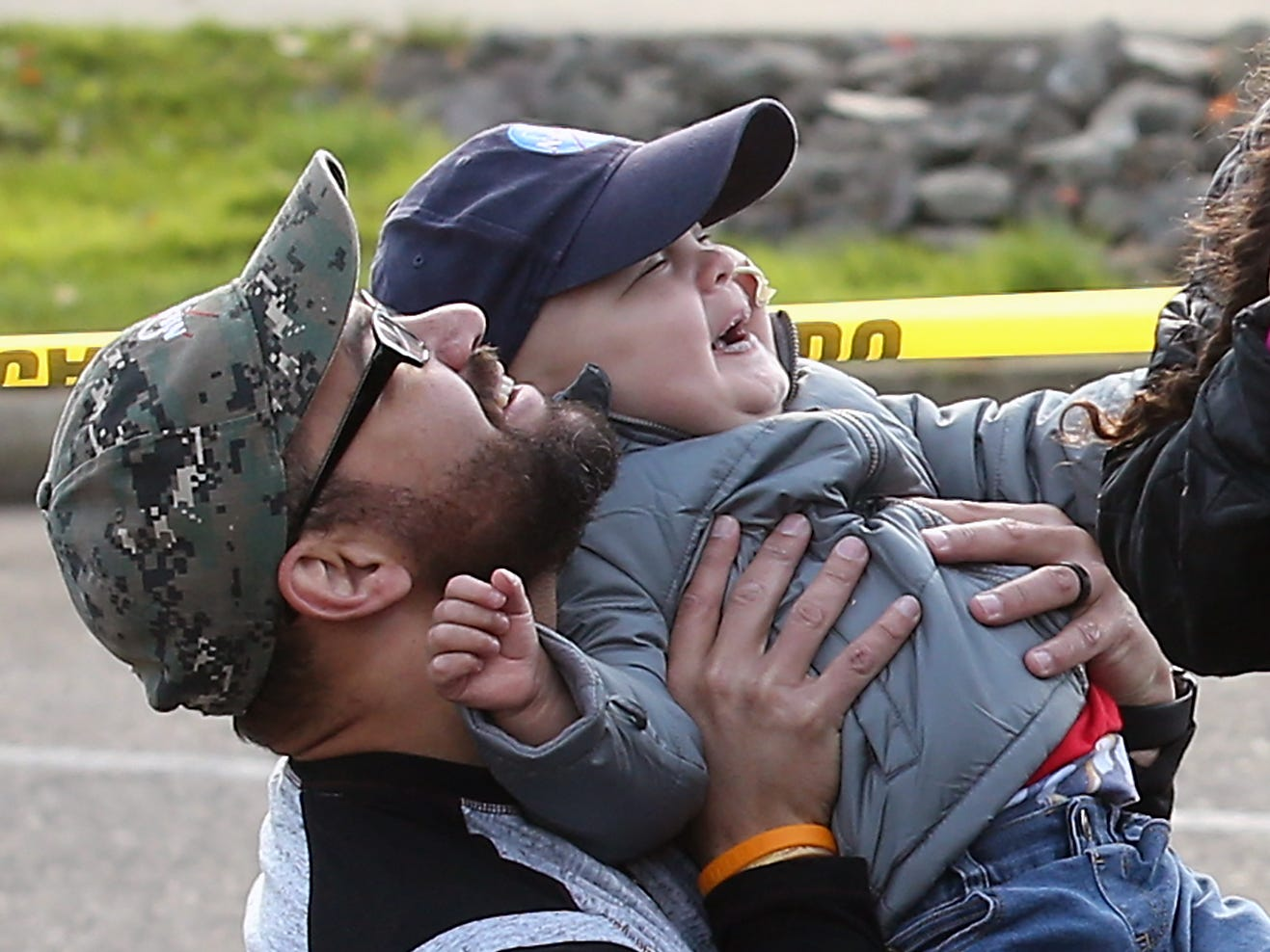 Three-year-old Jedi Minters laughs as his father Jason tips him up to see the Kitsap County Sheriff's Department's drone flying above them during the Jedi's Special Day event at the Port of Bremerton boat launch across from Port Orchard's City Hall on Wednesday, November 7, 2018.