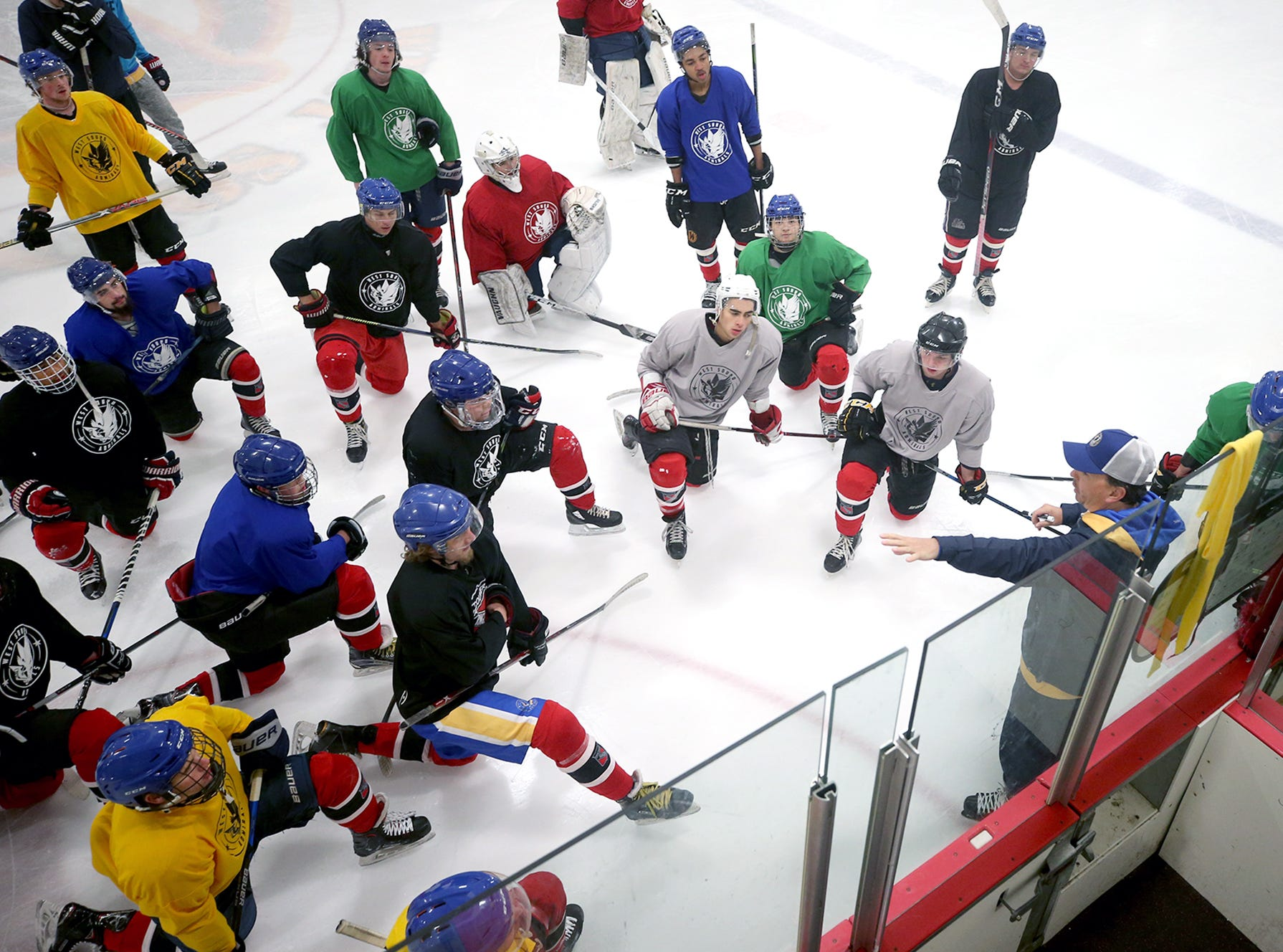 The West Sound Admirals hockey team practices at the Bremerton Ice Arena on November, 8, 2018. Head coach David Daniello, lower right, goes over a power play drill.