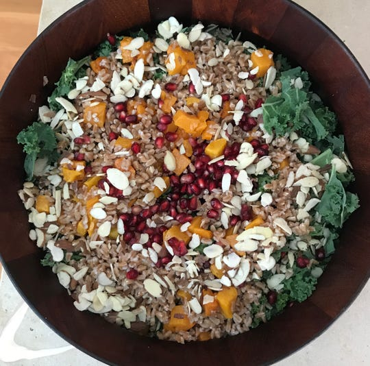 Vegan eating can be delicious, especially when it means a hearty salad with kale, roasted squash, pomegranate, farro and toasted almonds.