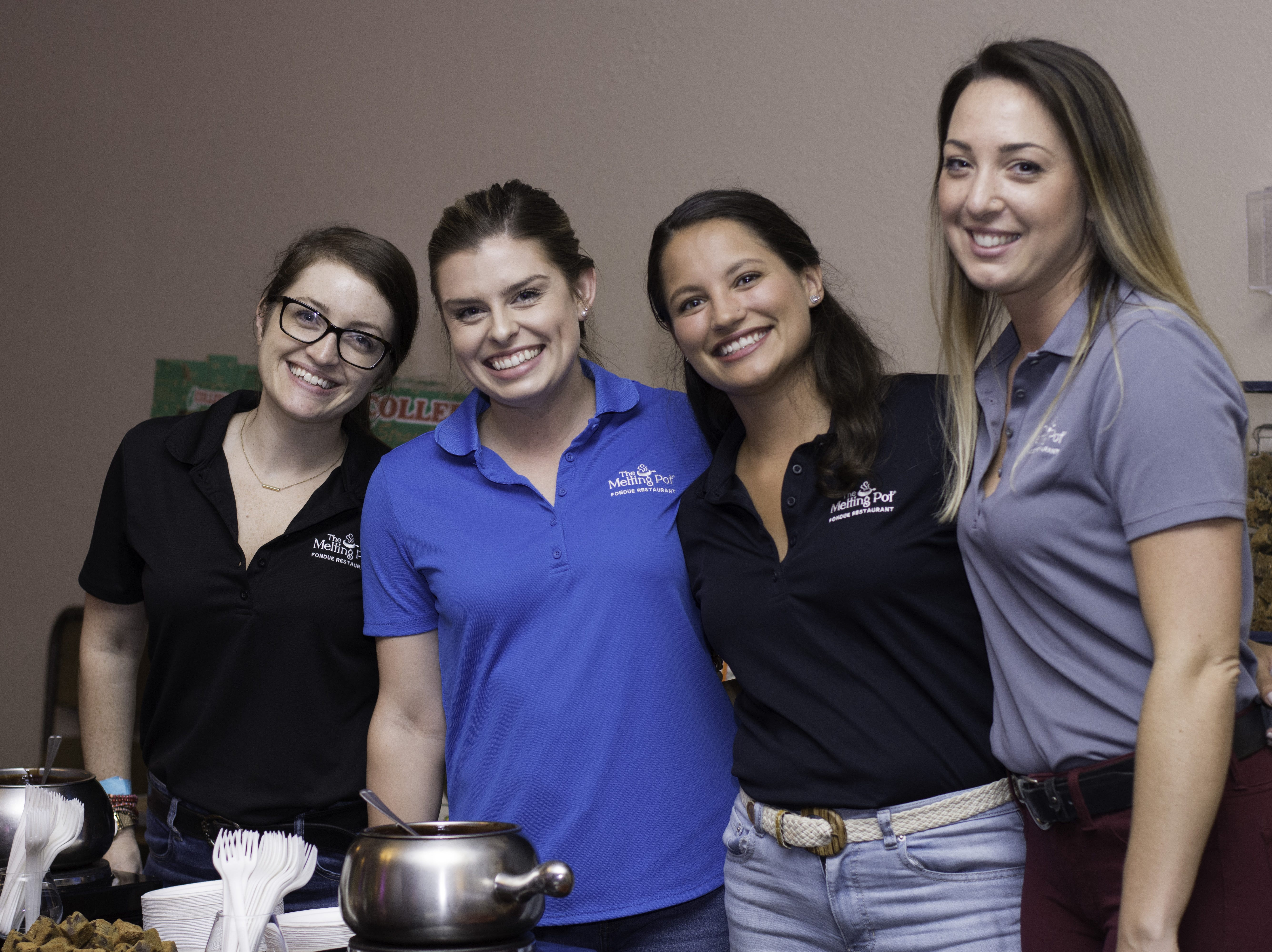 Melting Pot employees pose together at Jazzoo.