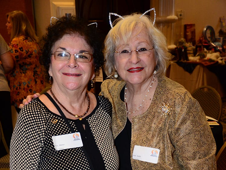 Terry Mellon and Joyce Scafidi ready to help the Space Coast Feline Network during the benefit for feral cats.