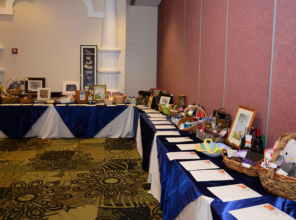 Lots of items to bid on during the Space Coast Feline Network Autumn Gala benefit held on Saturday evening. (photo by Tony Dees/for Florida Today)