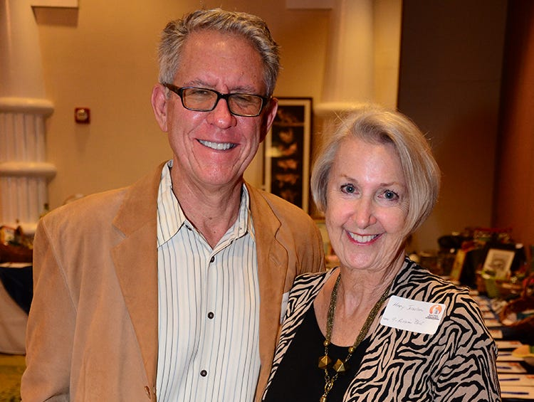 Mark and Mary Josselson pose for the camera Saturday night during the Space Coast Feline Network Autumn Gala.