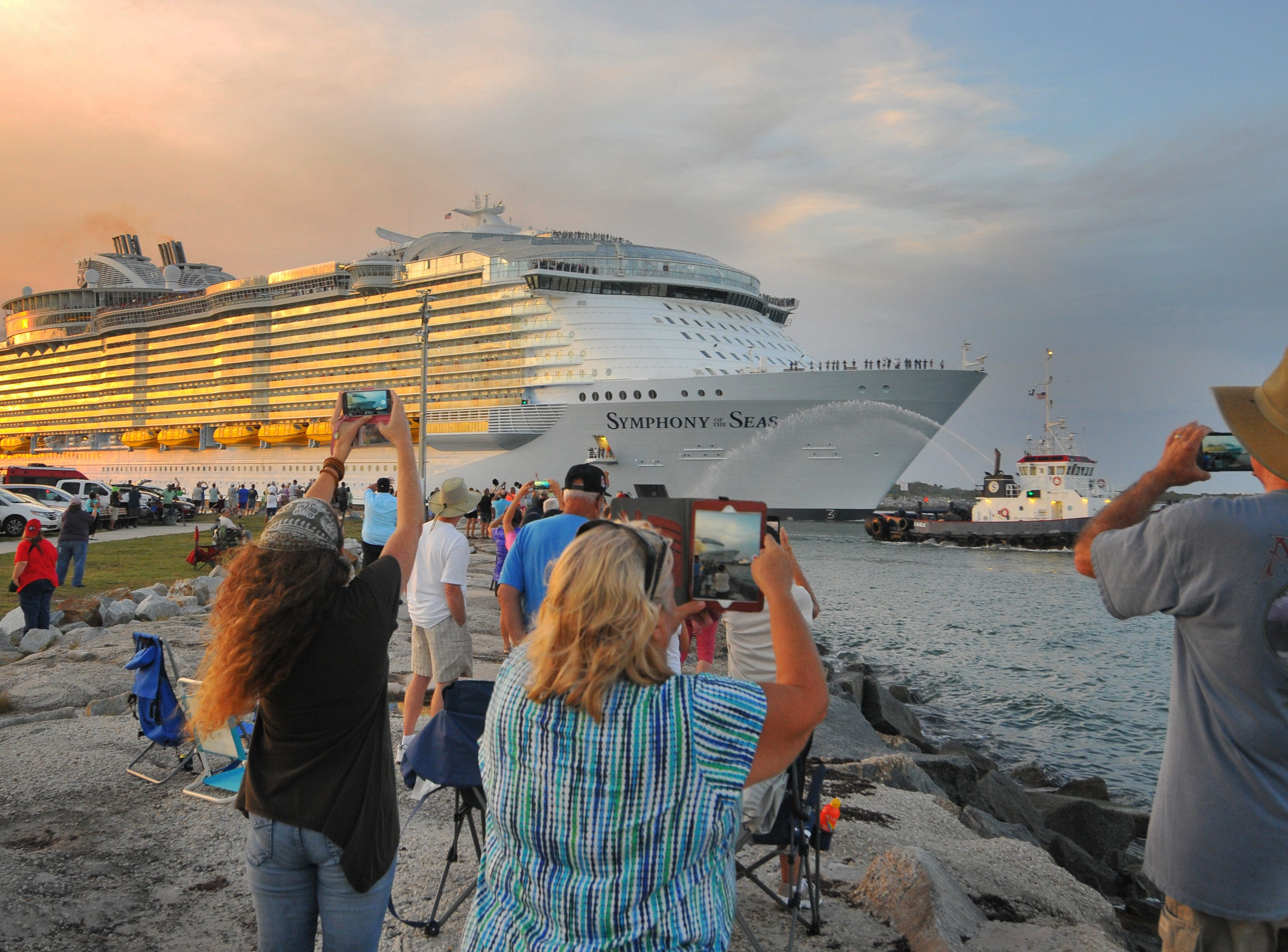 Crowds gathered at Jetty  Park  at Port Canaveral Thursday evening to watch the world's largest cruise ship, Royal Caribbean's Symphony of the Seas leave Port Canaveral. The ship was headed for its home port in Miami .