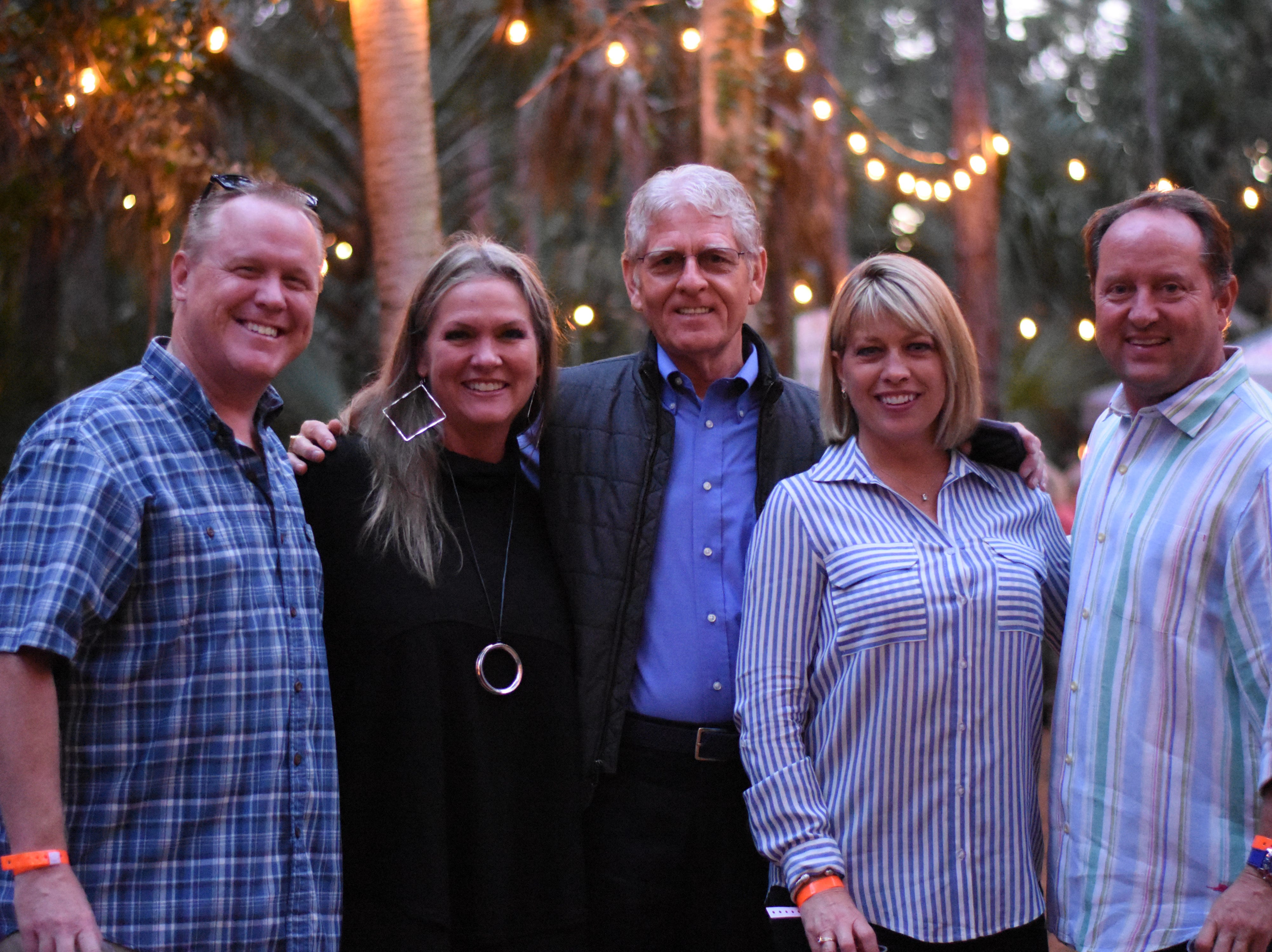 Todd and Cyndi Pokrywa, Mel Wingate, Deanna Tangeman, and Brent Peoples stand together inside the Cocoa Village walk through in the Premium Club at 2018's Jazzoo.