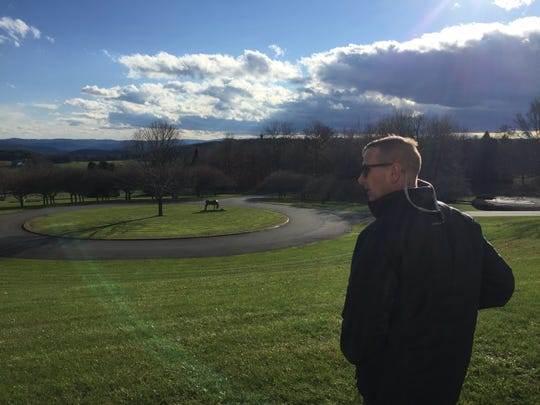 Bob Burke, director of the Vermont Office of Veterans Affairs, surveys the grounds at the Vermont Veterans Memorial Cemetery on Wednesday, Nov. 7, 2018.