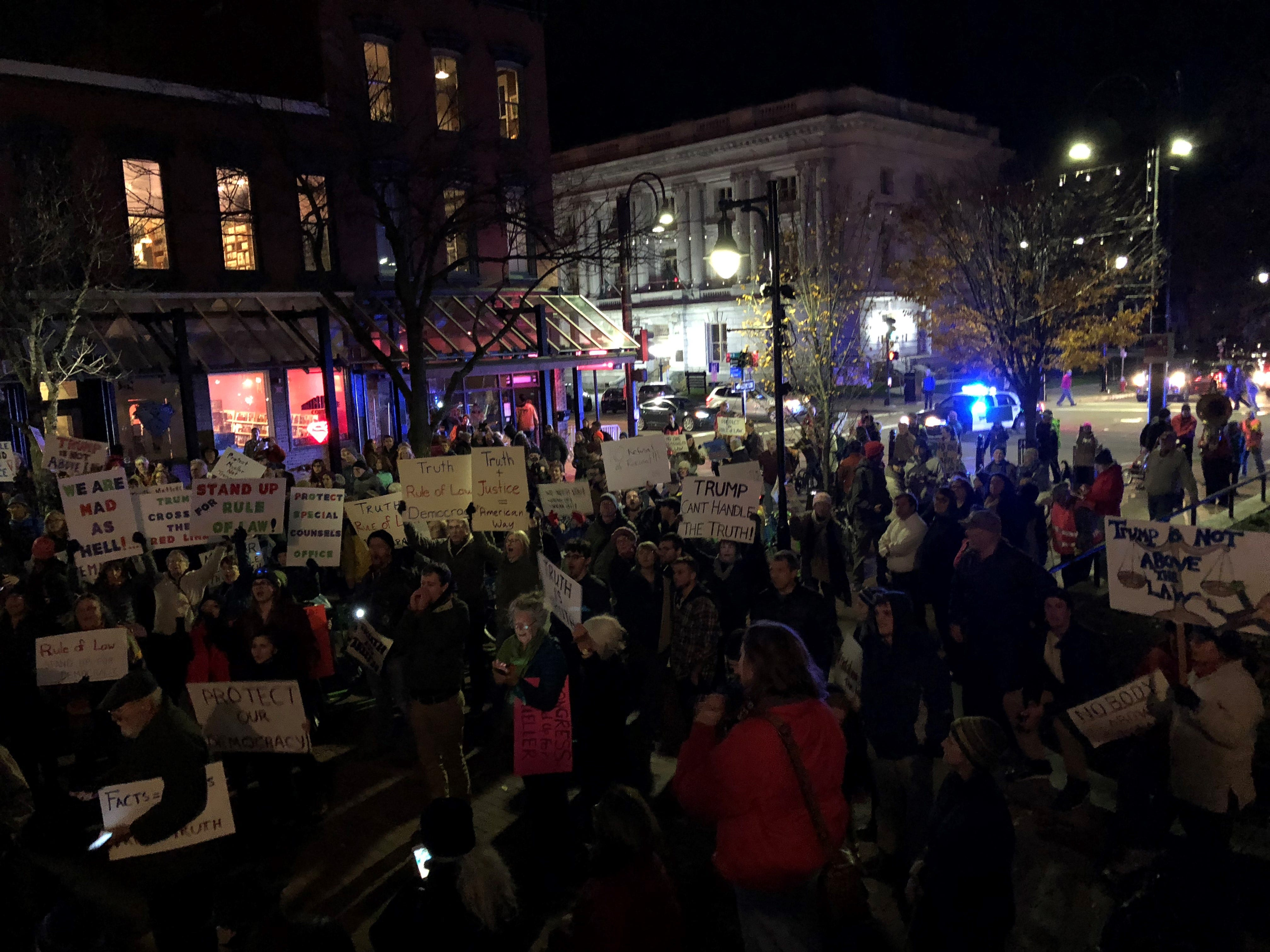 Protesters march on Nov. 8, 2018 in downtown Burlington to demand protection for Robert Mueller in the wake of President Donald Trump forcing out Attorney General Jeff Sessions