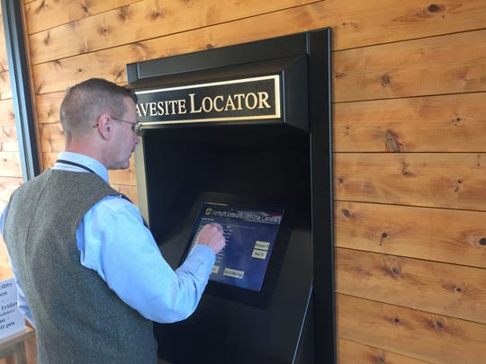 Bob Burke, director of the Vermont Office of Veterans Affairs, uses a grave-site locator at the Vermont Veterans Memorial Cemetery in Randolph Center.