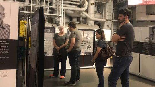 """Visitors at the Lexington Museum on the Bay explore """"The Texas Liberator: Witness to the Holocaust"""" exhibit Thursday, Nov. 8, 2018."""