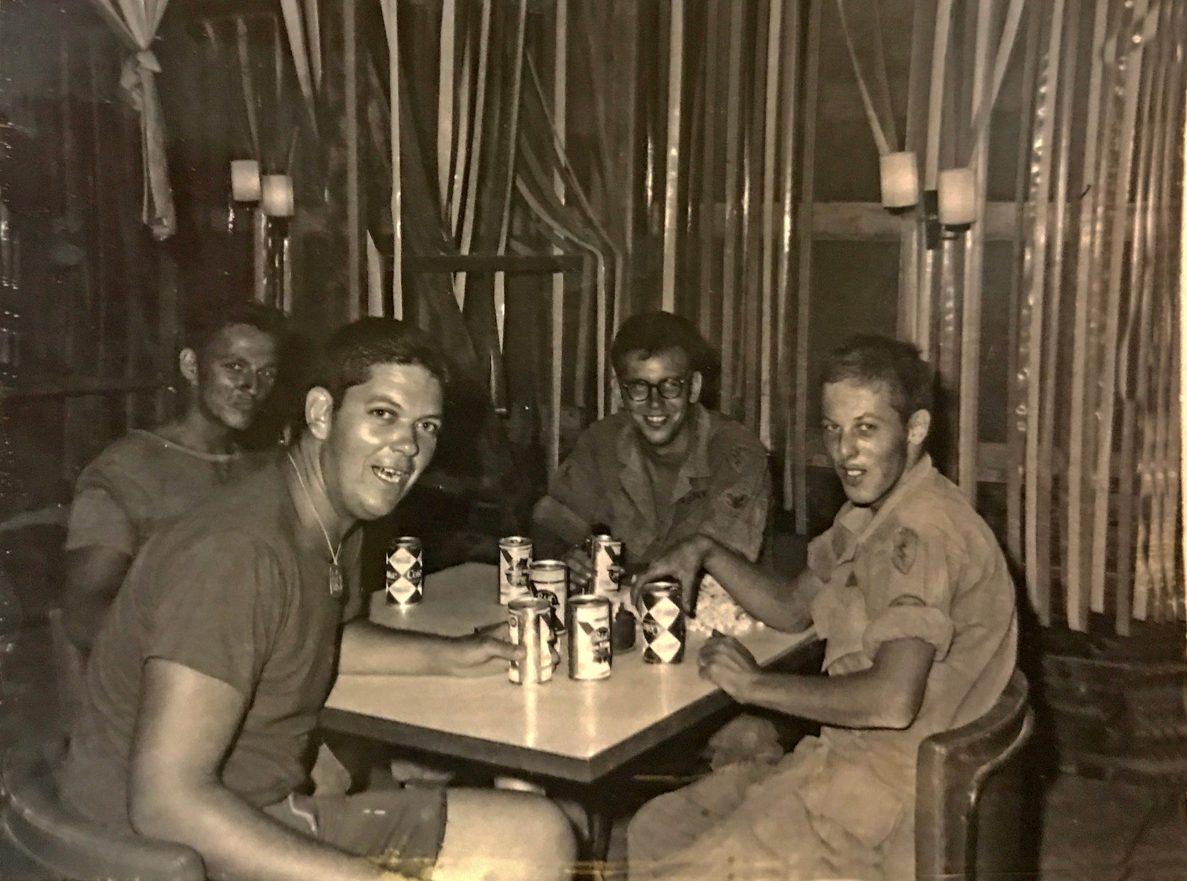 That Lloyd in the foreground, second from the left, relaxing with comrades in Vietnam.