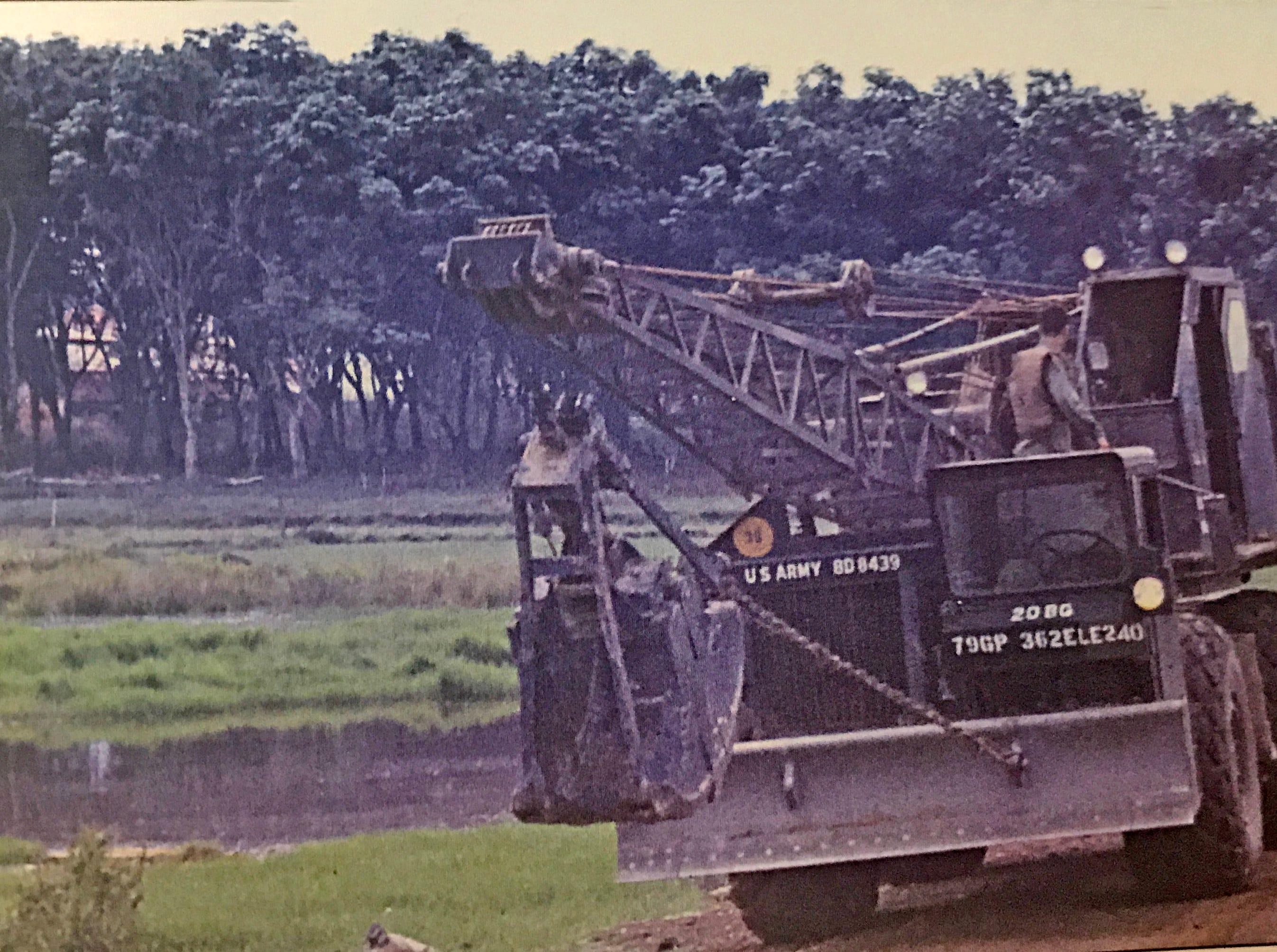 Lloyd and his crane in Vietnam.