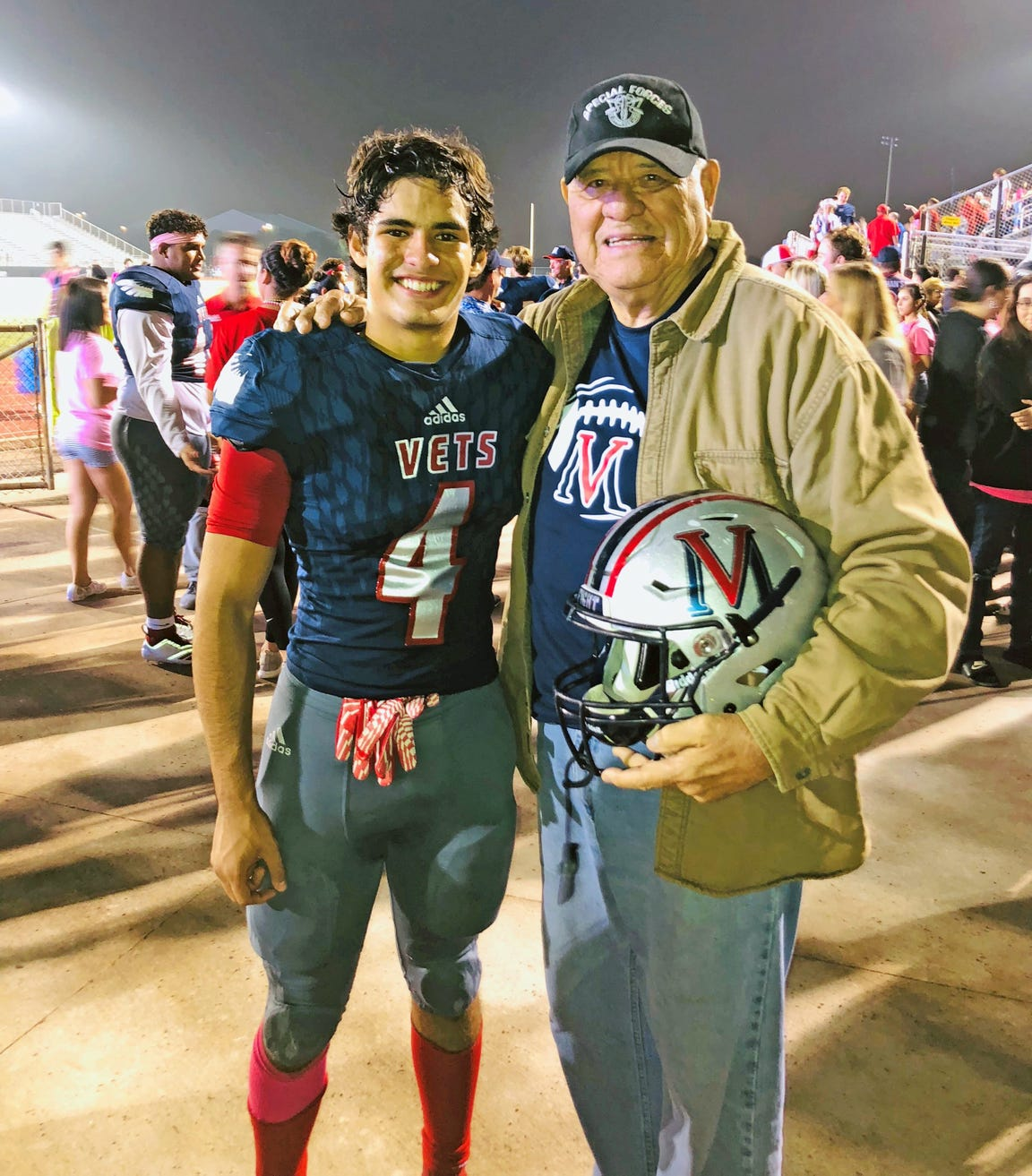 Army veteran Bill Creager and his great-grandson, Veterans Memorial player Joey Perez, participated in a veterans ceremony during this year's game between the Eagles and Flour Bluff Hornets.