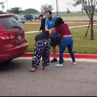 This video shows women fighting outside of Adkins Middle School drop off