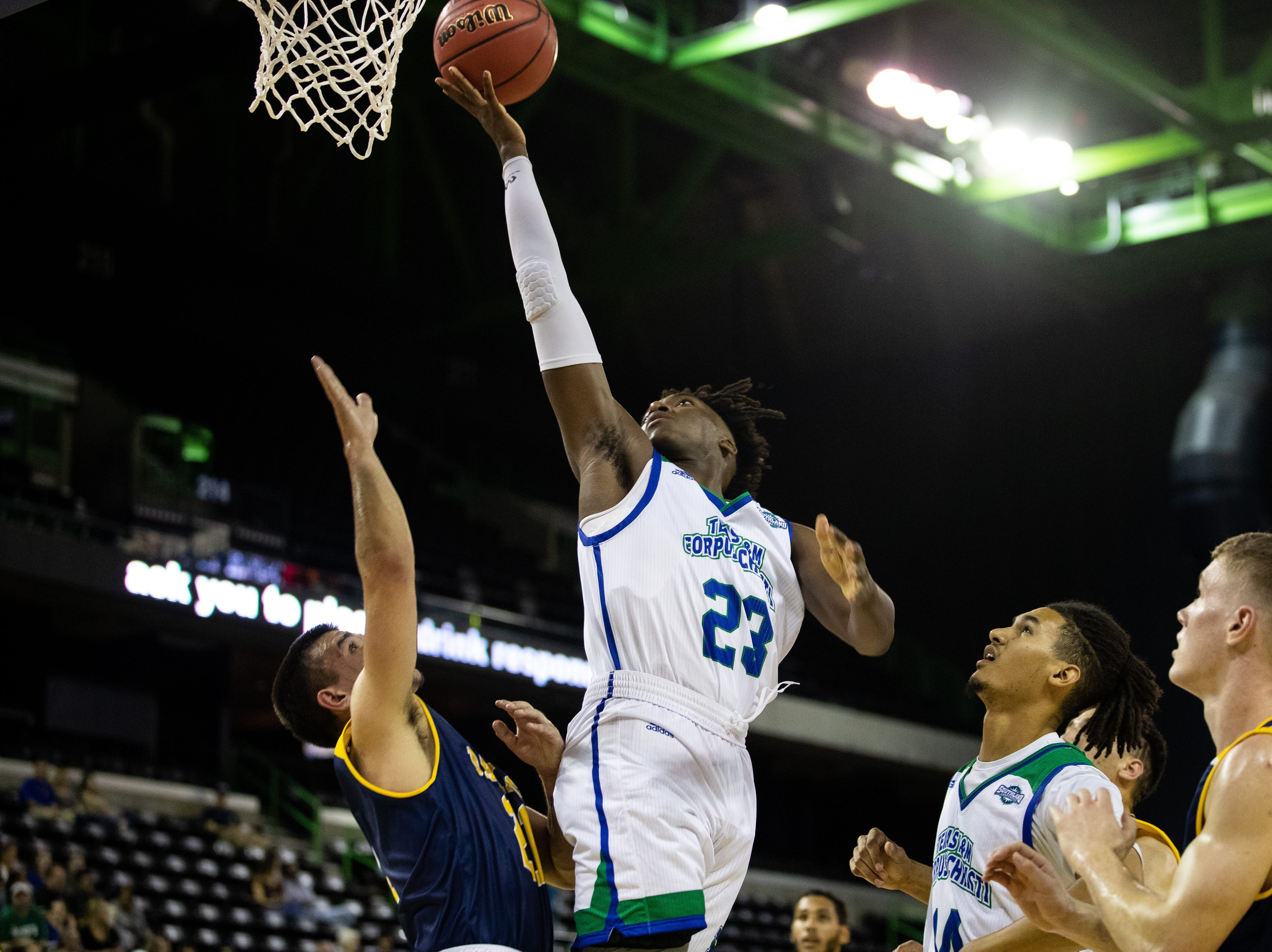Islanders Jalon Clark jumps to make a layup during their game against Howard Payne at the American Bank Center on Wednesday, Nov. 7, 2018.
