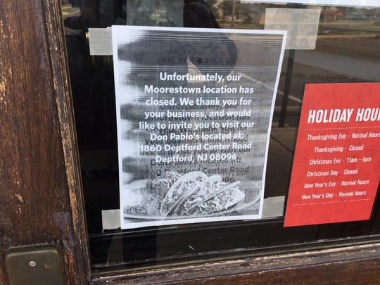 A sign on the door at the now-closed Don Pablo's restaurant in Moorestown directs customers to the Deptford location, one of only three remaining in the country.