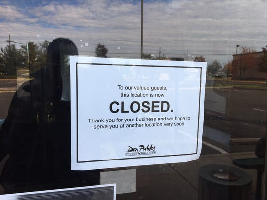 A sign on the door at the now-closed Don Pablo's restaurant in Moorestown informs customers that the restaurant is indeed closed.