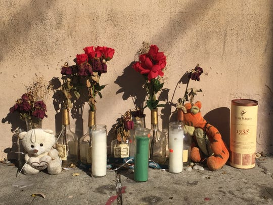 "Wilted roses mark a memorial to Jovany ""Macho"" Torres, a city man slain Oct. 6  outside Freddy's Grovery in East Camden."
