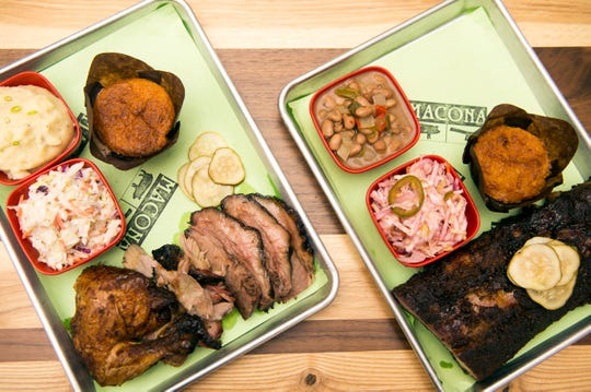 A three-meat plate (chicken, brisket, pork) with sides of mashed potatoes and mayo coleslaw, left, and a half-rack of ribs with sides of borrocho beans and vinegar coleslaw from Macona BBQ in Collingswood, N.J.