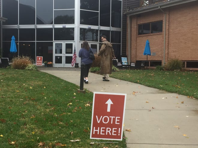 Voters walk to the polls Tuesday in Cherry Hill, where Gritty, the Flyers mascot, was an also-ran in the school board race.