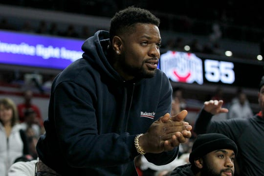 Cincinnati Bengals linebacker Vontaze Burfict cheers on the Bearcats in the second half of the NCAA basketball game between the Cincinnati Bearcats and the Ohio State Buckeyes at Fifth Third Arena in Cincinnati on Wednesday, Nov. 7, 2018. The Bearcats opened the season 0-1 with a 64-56 loss the Ohio State.